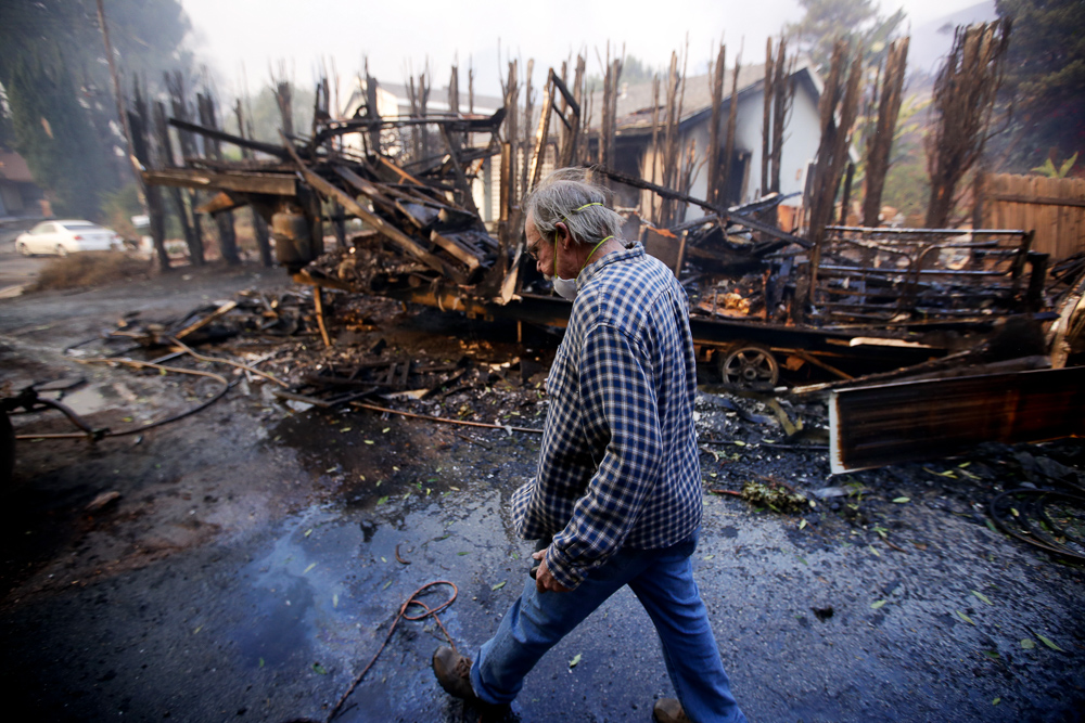 "<div class=""meta image-caption""><div class=""origin-logo origin-image none""><span>none</span></div><span class=""caption-text"">Homeowner Alan Barnard walks past the remains of his RV from a wildfire in the Lake View Terrace area of Los Angeles on Tuesday, Dec. 5, 2017. (Chris Carlson/AP Photo)</span></div>"