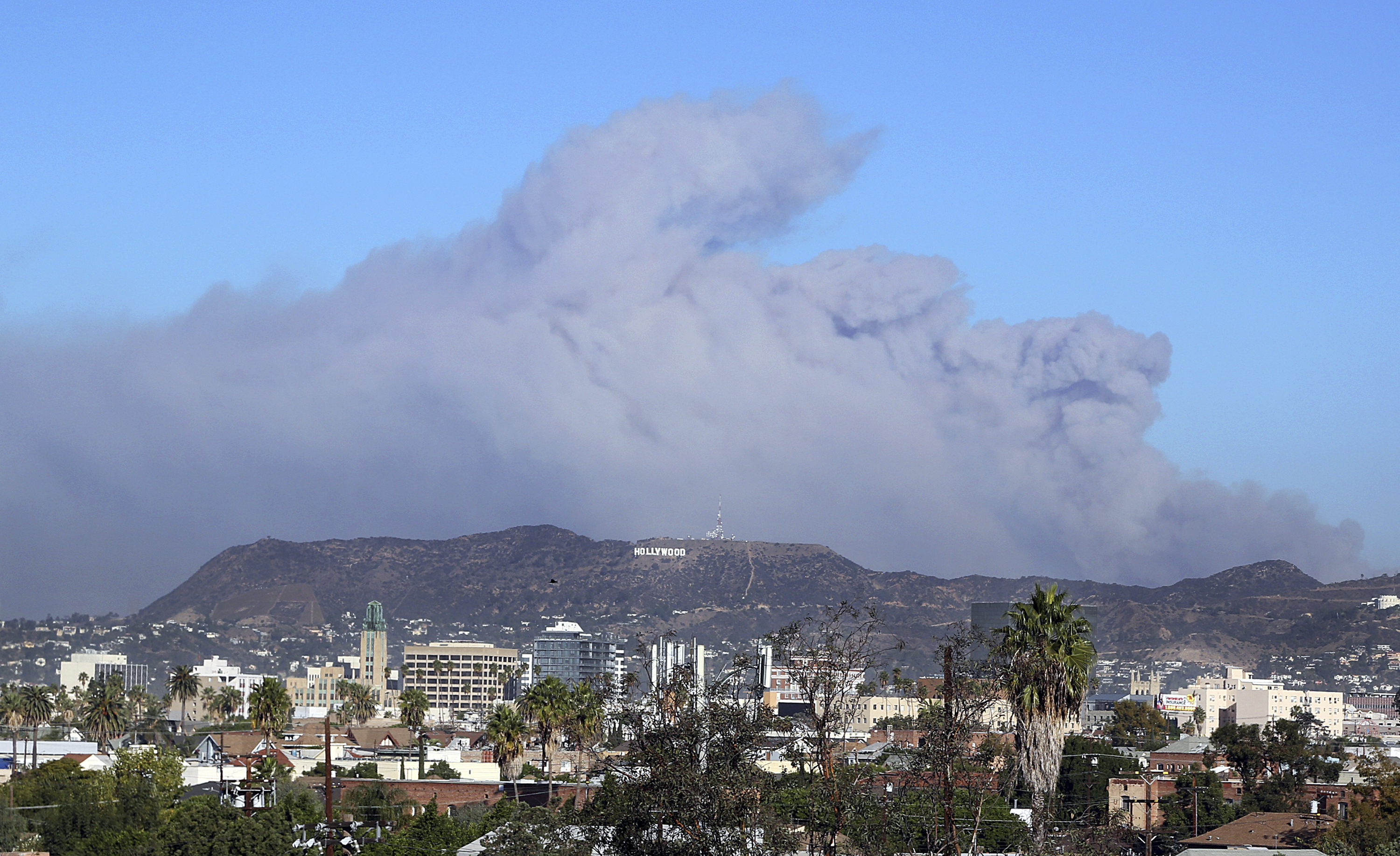 <div class='meta'><div class='origin-logo' data-origin='none'></div><span class='caption-text' data-credit='Reed Saxon/AP Photo'>Smoke from the Creek wildfire in the San Gabriel Mountains, the second range behind the Hollywood Hills, home of the Hollywood sign, looms up over Los Angeles on Dec. 5.</span></div>