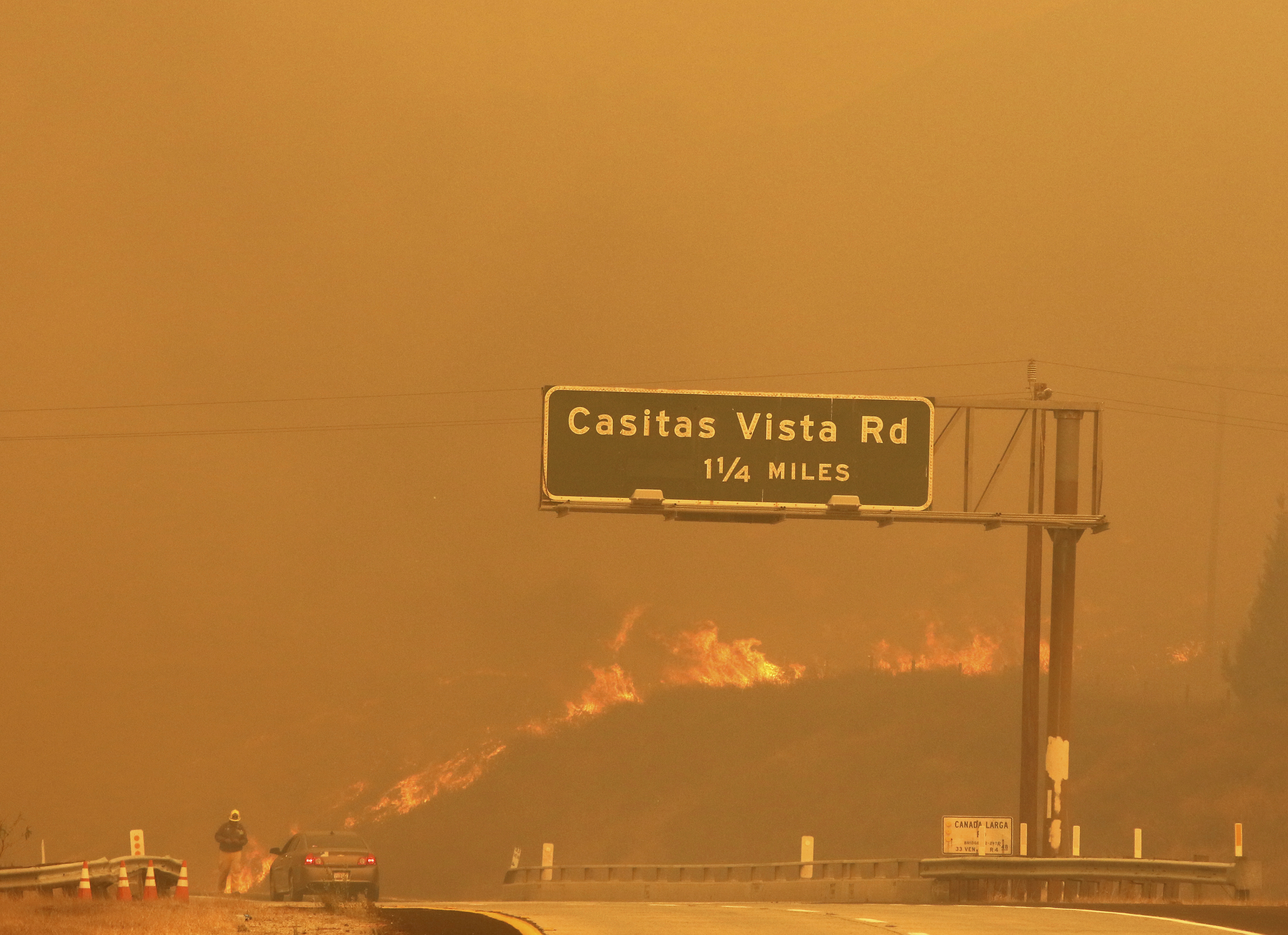 <div class='meta'><div class='origin-logo' data-origin='none'></div><span class='caption-text' data-credit='Daniel Dreifuss via AP'>Flames and smoke shroud State Route 33 as a wildfire burns in Ventura, Calif., Tuesday, Dec. 5, 2017.</span></div>