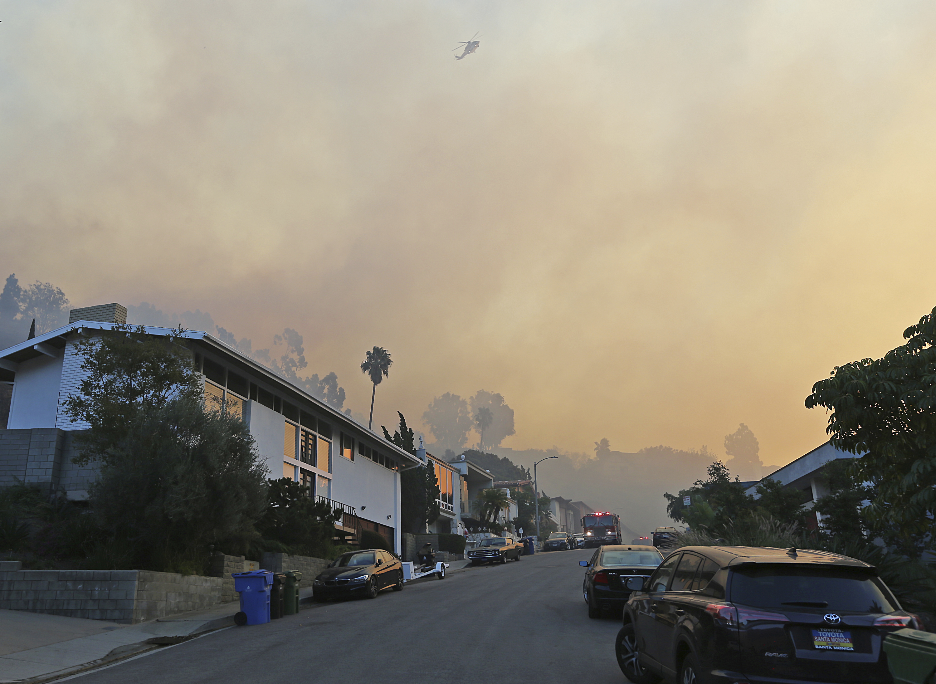 <div class='meta'><div class='origin-logo' data-origin='none'></div><span class='caption-text' data-credit='Reed Saxon/AP Photo'>Firefighters station engines on Bel Terrace and a helicopter prepares to make a water drop as the Skirball wildfire threatens the Bel Air district of Los Angeles, Dec. 6, 2017.</span></div>