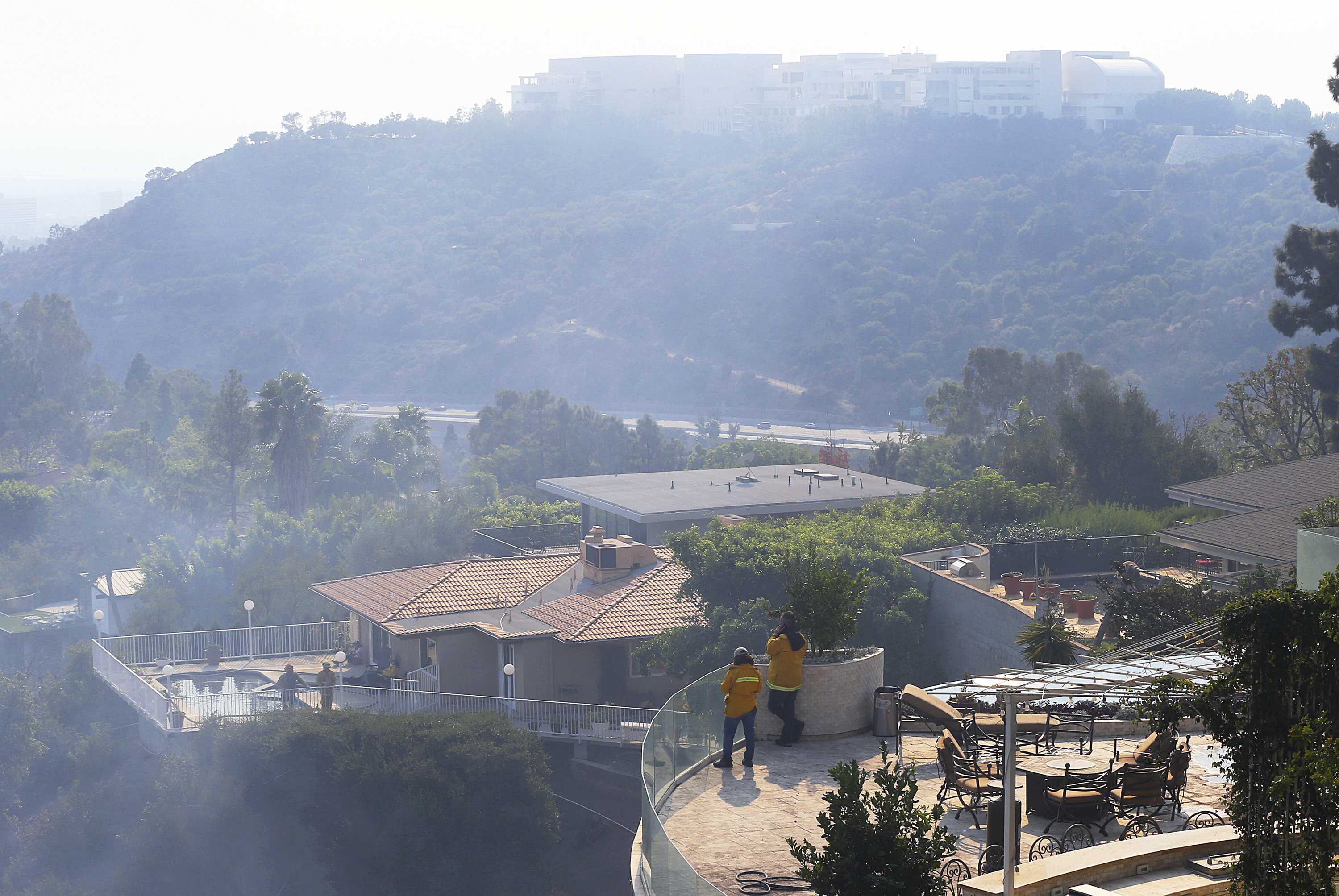 <div class='meta'><div class='origin-logo' data-origin='none'></div><span class='caption-text' data-credit='Reed Saxon/AP Photo'>The Getty Center lies shrouded in smoke as firefighters keep watch on a nearby canyon from the terraces of homes in the Bel Air district on Wednesday, Dec. 6, 2017.</span></div>