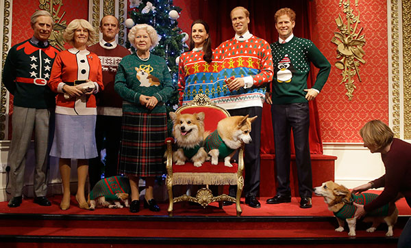 "<div class=""meta image-caption""><div class=""origin-logo origin-image none""><span>none</span></div><span class=""caption-text"">Two Welsh Pembrokeshire Corgi dogs sit on a chair in front of wax work models of the British Royal family wear colorful Christmas themed jumpers for a charity campaign. (Alastair Grant/AP Photo)</span></div>"