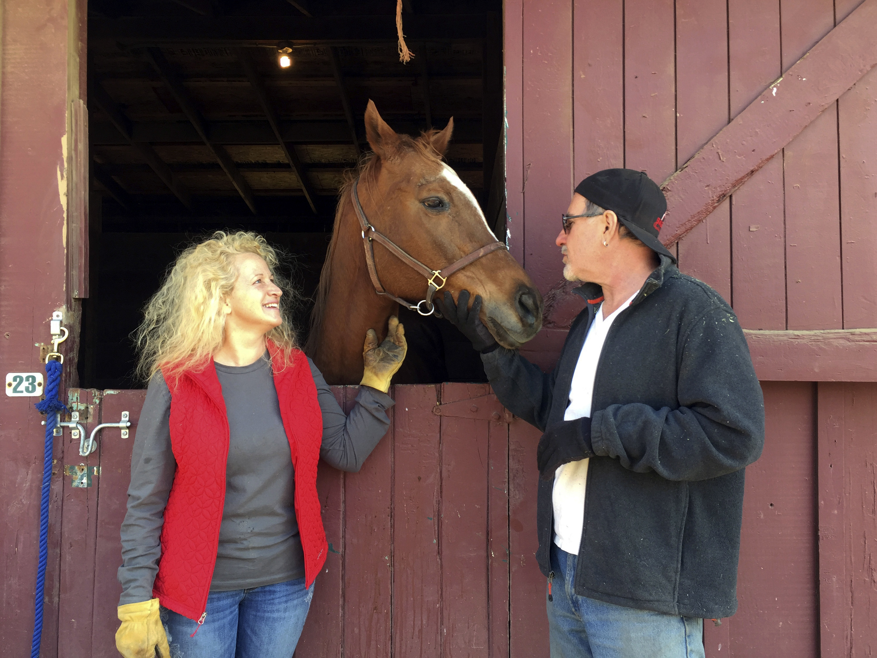 "<div class=""meta image-caption""><div class=""origin-logo origin-image none""><span>none</span></div><span class=""caption-text"">Brian Bromberg and Wendy Frank pose with one of the horses they rescued from their Ojai, Calif., home. They're calling their survival and that of their beloved horses a miracle. (Amanda Lee Myers/AP Photo)</span></div>"