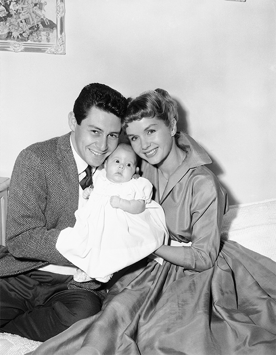 "<div class=""meta image-caption""><div class=""origin-logo origin-image none""><span>none</span></div><span class=""caption-text"">Eddie Fisher and Debbie Reynolds with their young daughter, Carrie Frances Fisher, in Hollywood, Jan. 2, 1957. (AP Photo)</span></div>"