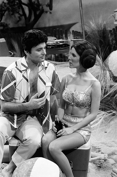 "<div class=""meta image-caption""><div class=""origin-logo origin-image none""><span>none</span></div><span class=""caption-text"">Bill Murray as Frankie Avalon, Carrie Fisher as Princess Leia during ""Beach Blanket Bimbo from Outer Space"" skit on November 18, 1978. (Al Levine/NBCU Photo Bank/Getty Images)</span></div>"