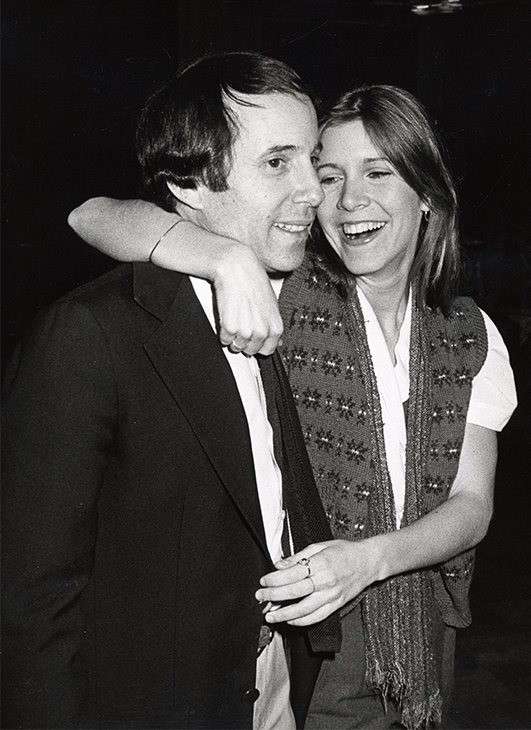 <div class='meta'><div class='origin-logo' data-origin='none'></div><span class='caption-text' data-credit='Ron Galella/WireImage/Getty Images'>Paul Simon and Carrie Fisher, circa 1979.</span></div>