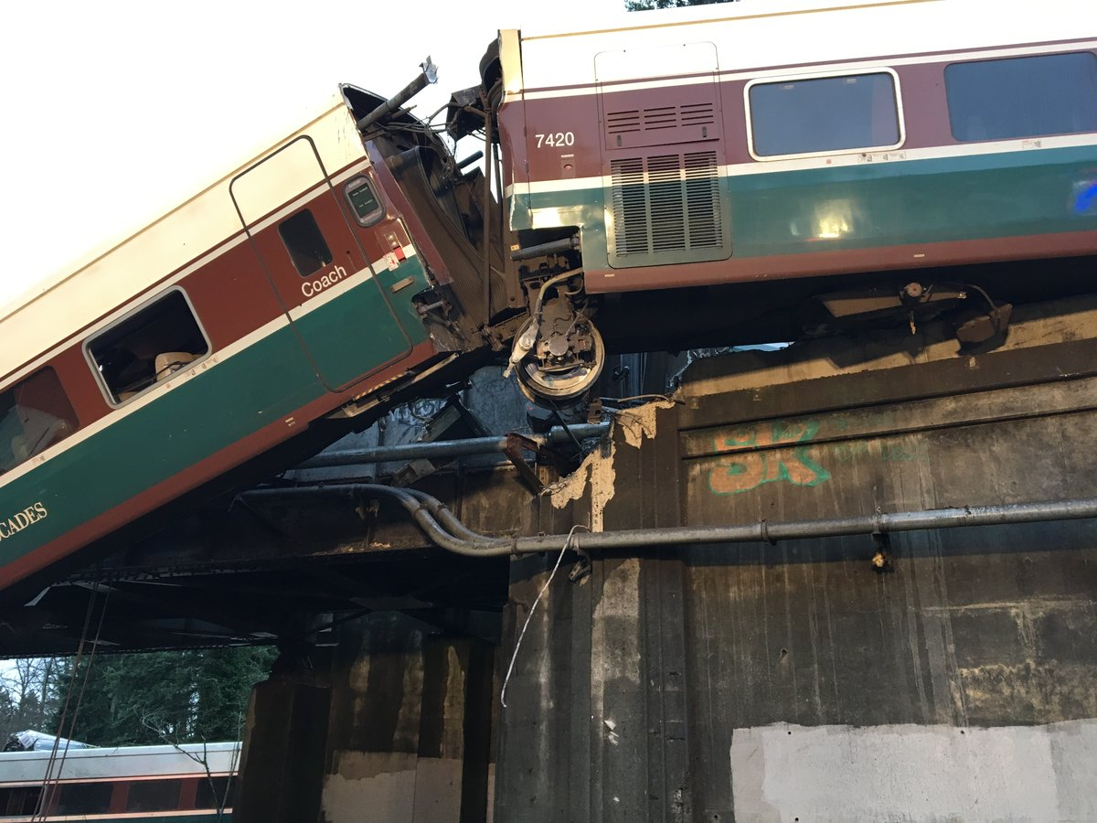 amtrak derailment train car dangles over washington interstate at least 3 dead officials say. Black Bedroom Furniture Sets. Home Design Ideas