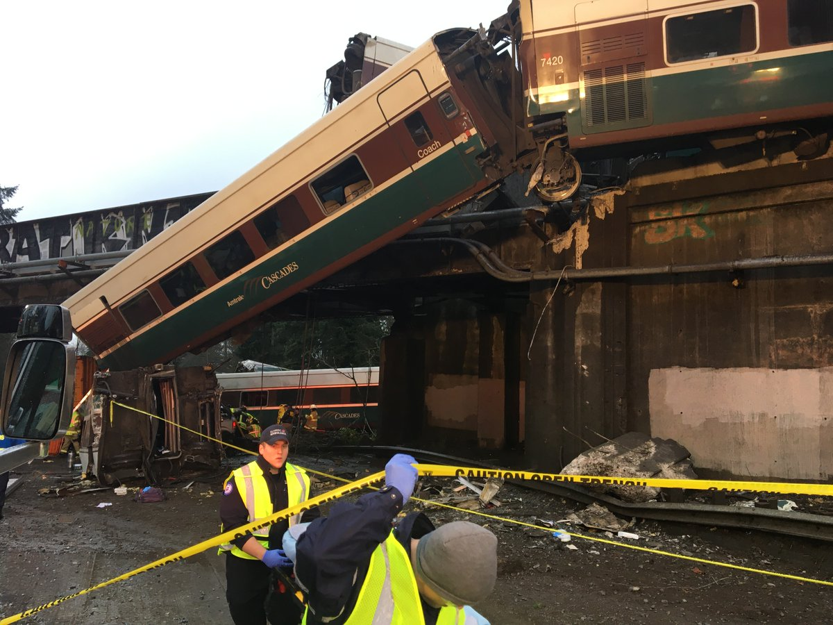 "<div class=""meta image-caption""><div class=""origin-logo origin-image none""><span>none</span></div><span class=""caption-text"">Photos from the Pierce County Sheriff's Department show the aftermath of a fatal train derailment near Tacoma. (Pierce County Sheriff's Department/Twitter)</span></div>"