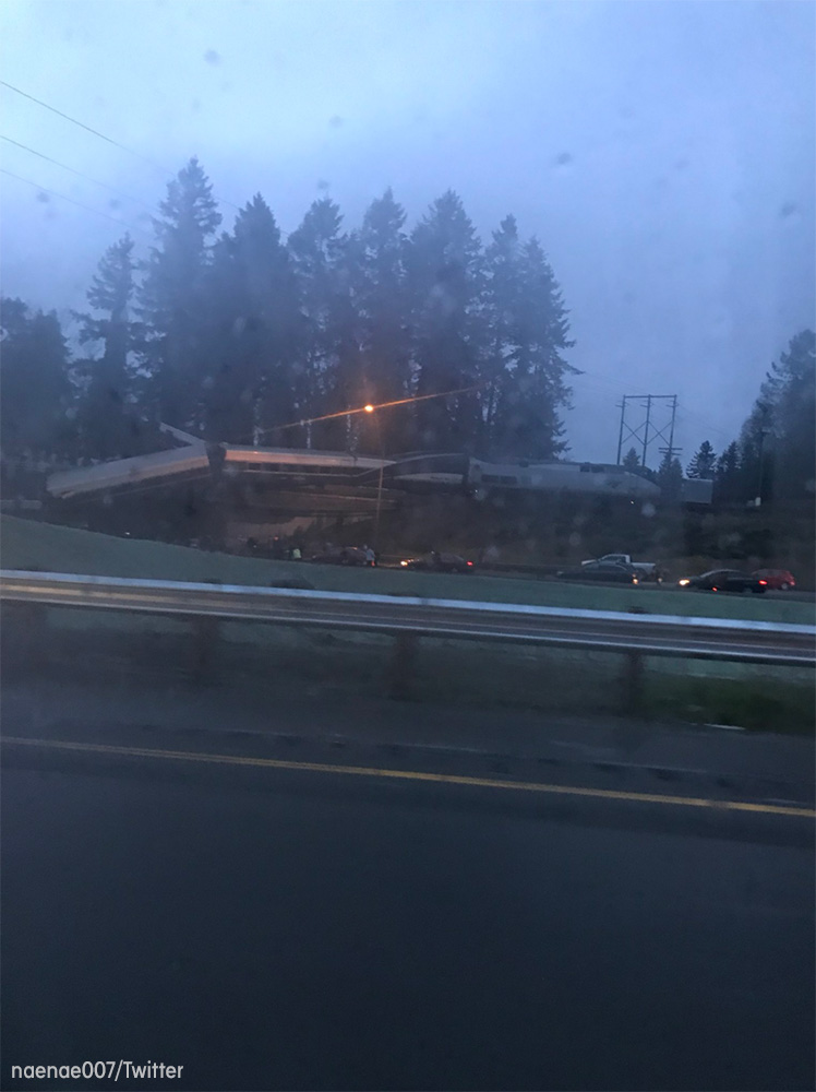 "<div class=""meta image-caption""><div class=""origin-logo origin-image none""><span>none</span></div><span class=""caption-text"">An Amtrak train traveling between Seattle and Portland derailed and fell off an overpass onto Interstate-5 south of Tacoma, Washington. (naenae007/Twitter)</span></div>"