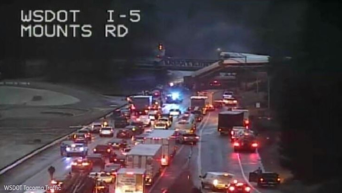 "<div class=""meta image-caption""><div class=""origin-logo origin-image none""><span>none</span></div><span class=""caption-text"">An Amtrak train traveling between Seattle and Portland derailed and fell off an overpass onto Interstate-5 south of Tacoma, Washington. (WSDOT Tacoma Traffic)</span></div>"