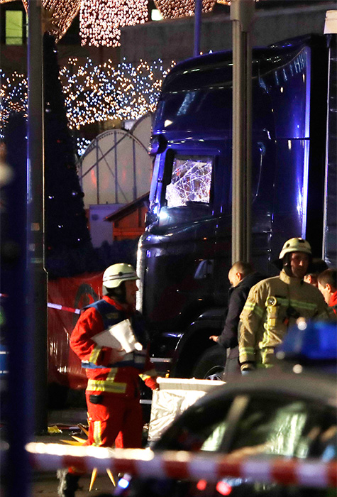 "<div class=""meta image-caption""><div class=""origin-logo origin-image ap""><span>AP</span></div><span class=""caption-text"">Firefighters walk past a truck which ran into a crowded Christmas market in Berlin, Germany, Monday, Dec. 19, 2016. (Michael Sohn/AP)</span></div>"