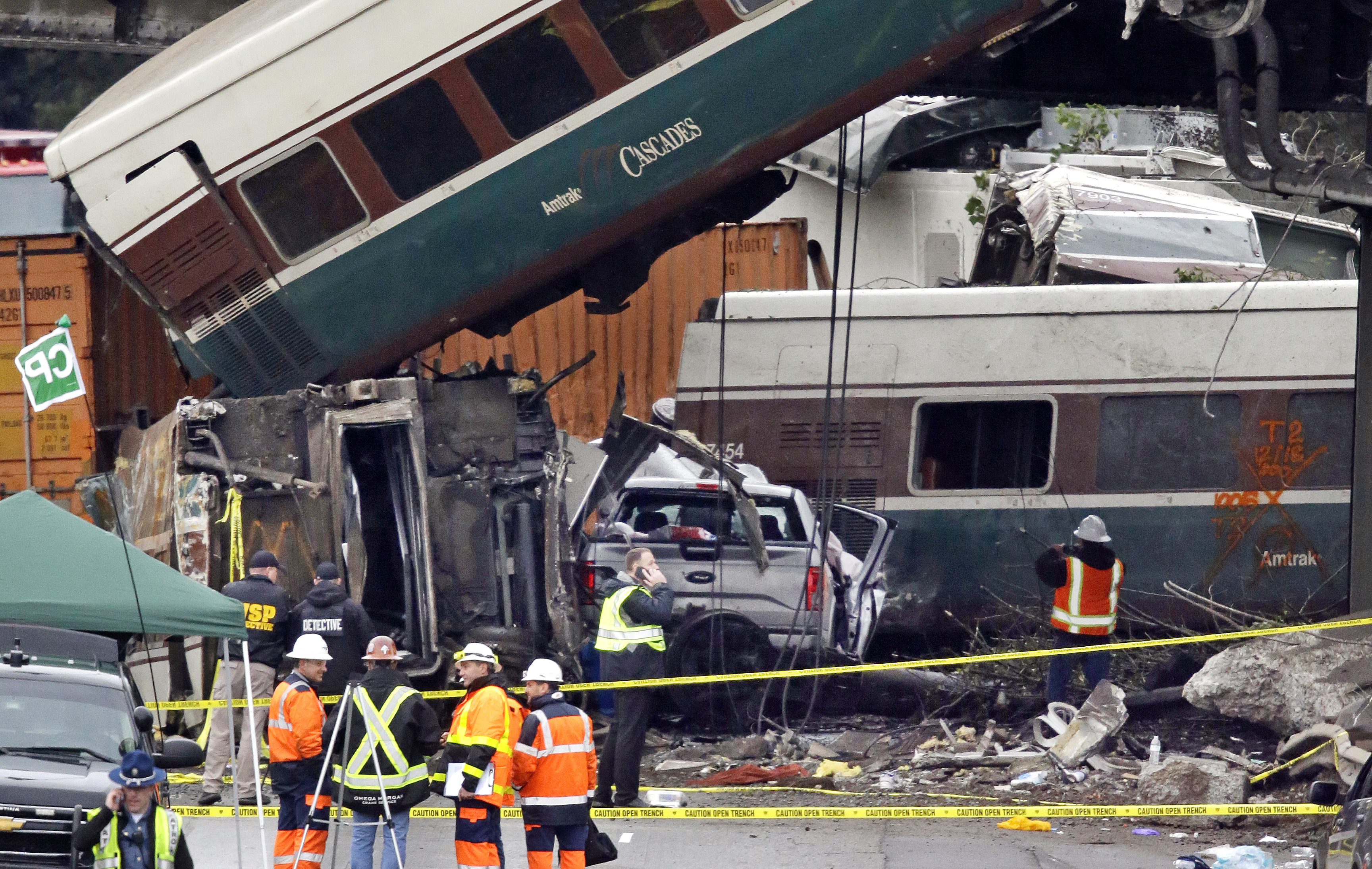 <div class='meta'><div class='origin-logo' data-origin='none'></div><span class='caption-text' data-credit='Elaine Thompson/AP Photo'>Cars from an Amtrak train that derailed above lay spilled onto Interstate 5 alongside smashed vehicles Monday, Dec. 18, 2017, in DuPont, Wash.</span></div>