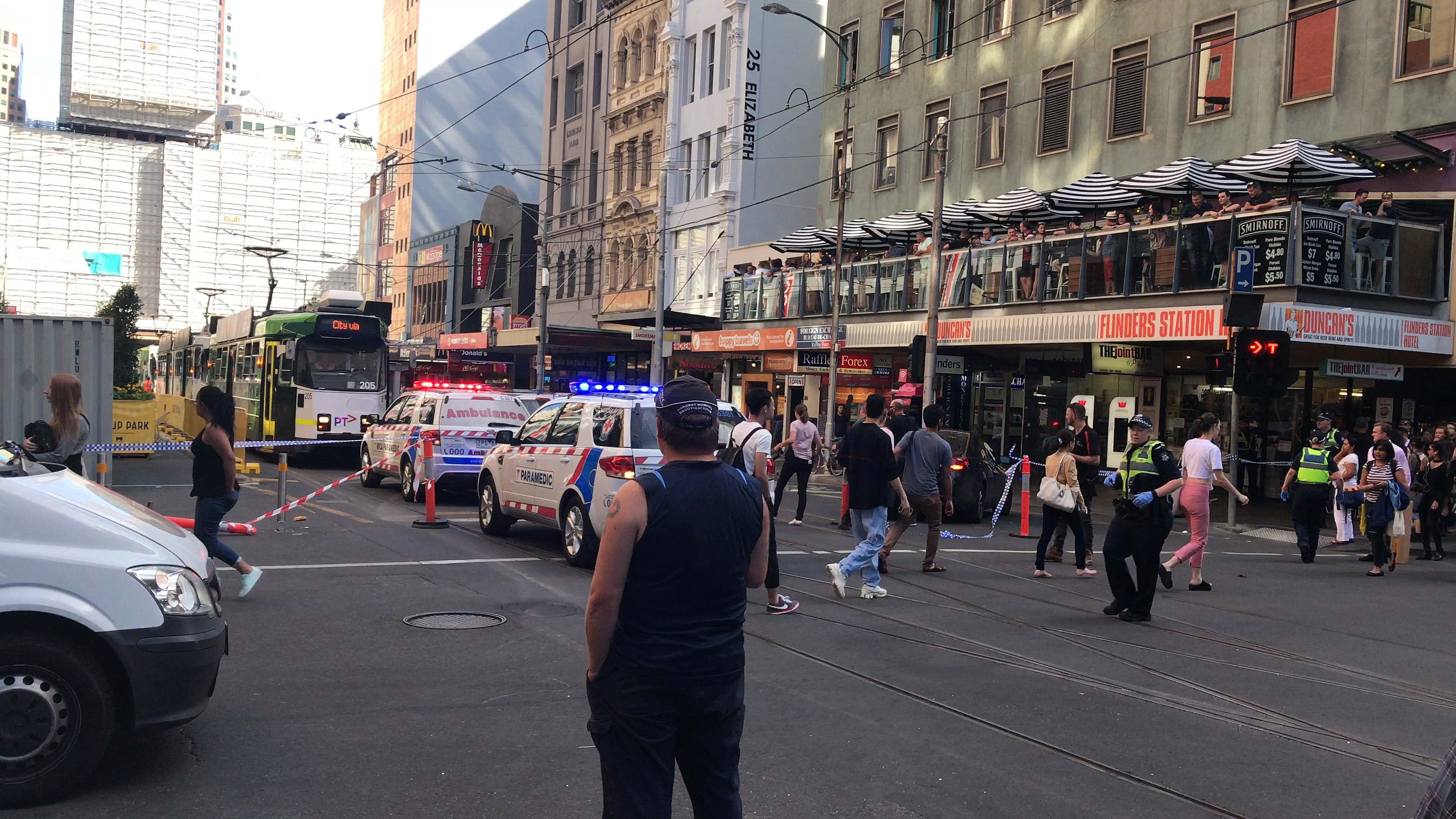 "<div class=""meta image-caption""><div class=""origin-logo origin-image none""><span>none</span></div><span class=""caption-text"">Pedestrians walk past as police and emergency services attend the scene of an incident involving a vehicle and pedestrians in Melbourne, Thursday, Dec. 21, 2017. (Kaitlyn Offer/AAP Image via AP)</span></div>"