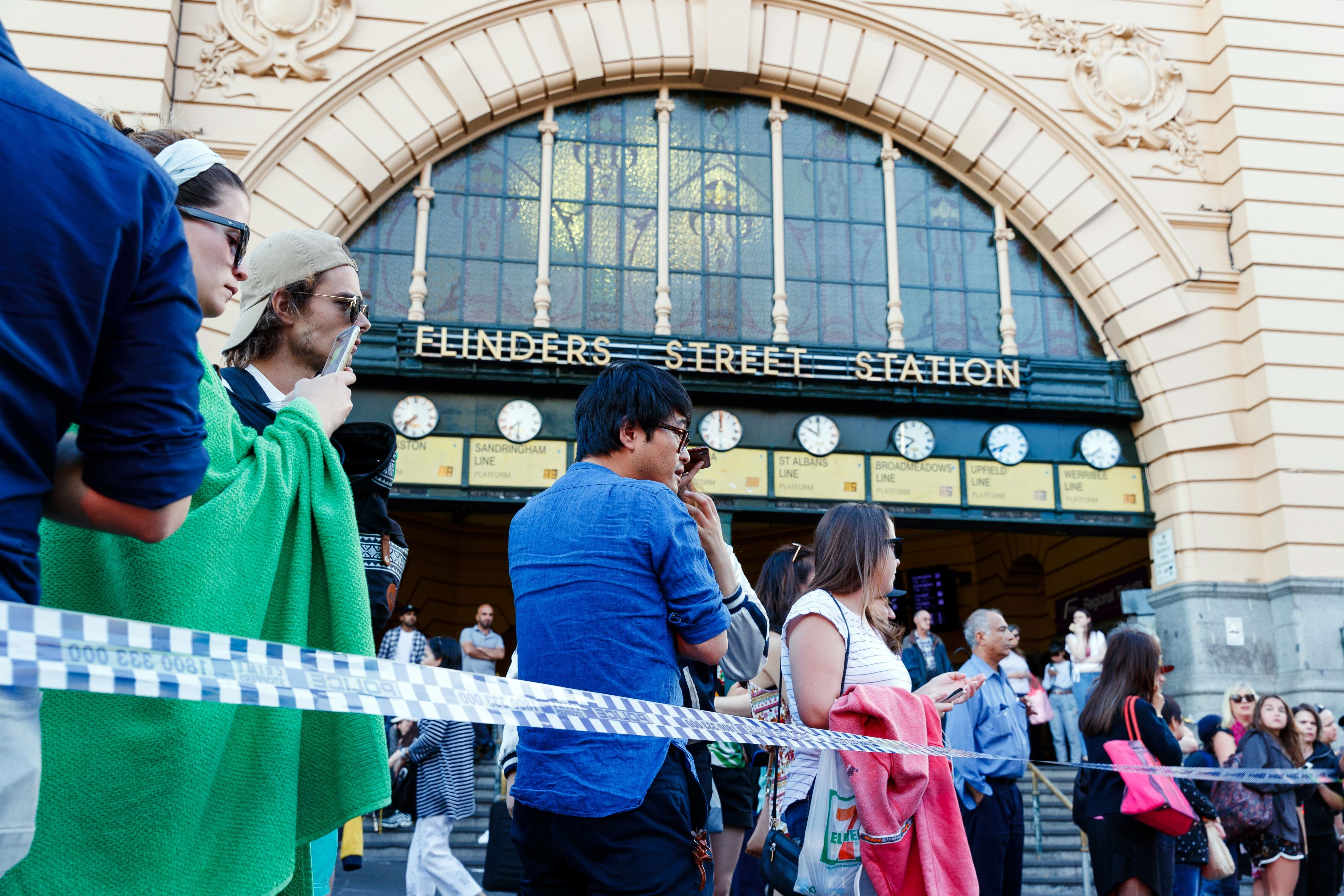 "<div class=""meta image-caption""><div class=""origin-logo origin-image none""><span>none</span></div><span class=""caption-text"">People gather at the scene of where a car ran over pedestrians in Flinders Street in Melbourne on December 21, 2017. (MARK PETERSON/AFP/Getty Images)</span></div>"