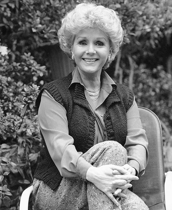 <div class='meta'><div class='origin-logo' data-origin='AP'></div><span class='caption-text' data-credit='AP Photo'>Debbie Reynolds smiles at her home, April 1986.</span></div>