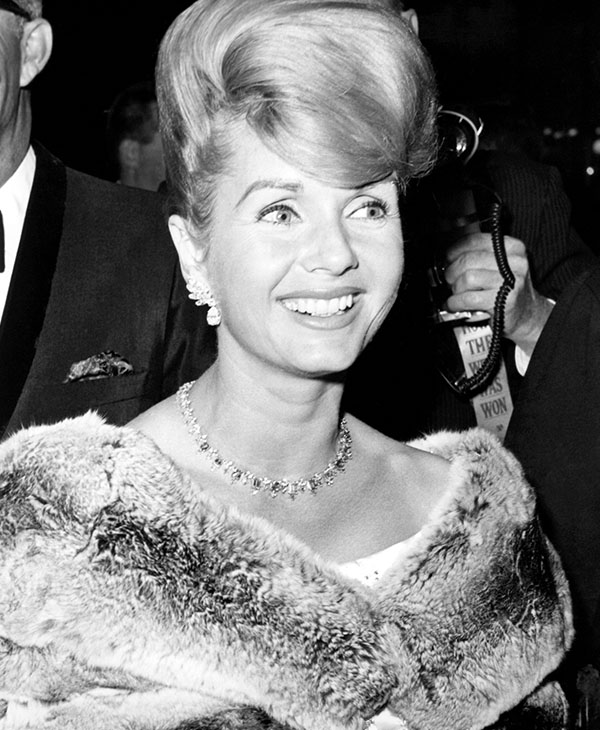 <div class='meta'><div class='origin-logo' data-origin='AP'></div><span class='caption-text' data-credit='AP Photo'>Debbie Reynolds is shown, Feb. 27, 1964.</span></div>