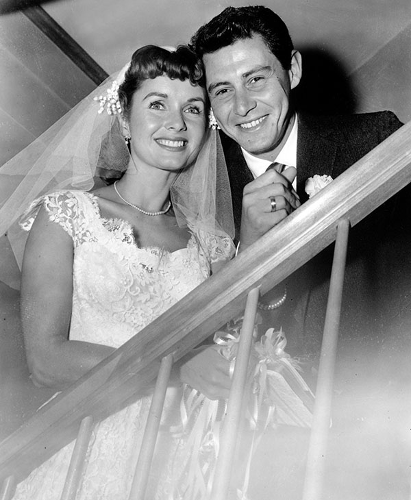 <div class='meta'><div class='origin-logo' data-origin='AP'></div><span class='caption-text' data-credit='AP Photo/Marty Lederhandler'>Actress Debbie Reynolds and singer Eddie Fisher smile in a pose following their brief marriage ceremony by a county judge at Grossinger, N.Y. on Sept. 26, 1955.</span></div>