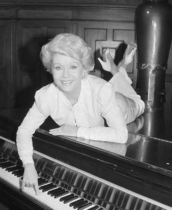 <div class='meta'><div class='origin-logo' data-origin='AP'></div><span class='caption-text' data-credit='AP Photo/Marty Lederhandler'>Actress Debbie Reynolds poses on a grand piano at a New York restaurant, Tuesday, Sept. 8, 1982.</span></div>