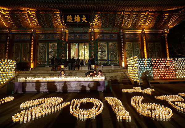 <div class='meta'><div class='origin-logo' data-origin='none'></div><span class='caption-text' data-credit='AP Photo/Ahn Young-joon'>Buddhists light candles during New Year's celebrations at Jogye Buddhist temple in Seoul, South Korea, early Friday, Jan. 1, 2016.</span></div>