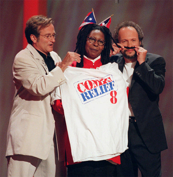 <div class='meta'><div class='origin-logo' data-origin='none'></div><span class='caption-text' data-credit='AP'>Williams, Whoopi Goldberg, and Billy Crystal on stage at the Comic Relief 8 event in 1998.</span></div>