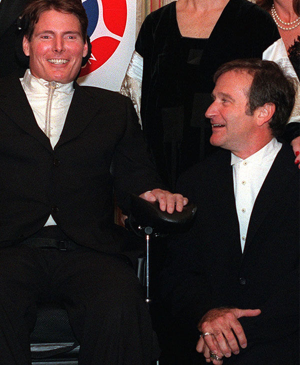 Williams putting a smile on &#34;Superman&#34; actor Christopher Reeve's face in 1998. <span class=meta>AP</span>