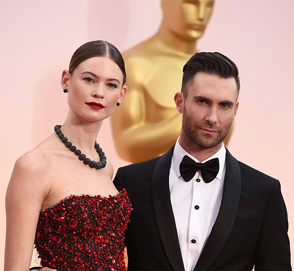 "<div class=""meta image-caption""><div class=""origin-logo origin-image none""><span>none</span></div><span class=""caption-text"">Adam Levine, right, and Behati Prinsloo arrive. (AP Photo)</span></div>"