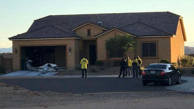 <div class='meta'><div class='origin-logo' data-origin='AP'></div><span class='caption-text' data-credit='Mesquite Police via AP'>In this photo provided by the Mesquite, Nev., Police Department, police personnel stand outside the home of Stephen Paddock on Monday, Oct. 2, 2017, in Mesquite.</span></div>