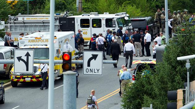 <div class='meta'><div class='origin-logo' data-origin='AP'></div><span class='caption-text' data-credit='AP Photo/Jose Luis Magana'>Authorities stage at the building entrance after multiple people were shot at The Capital Gazette newspaper in Annapolis, Md., Thursday, June 28, 2018.</span></div>