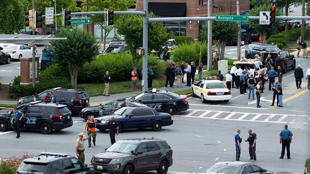<div class='meta'><div class='origin-logo' data-origin='AP'></div><span class='caption-text' data-credit='AP Photo/Jose Luis Magana'>Maryland police officers block the intersection at the building entrance after multiple people were shot at a newspaper in Annapolis, Md., Thursday, June 28, 2018.</span></div>