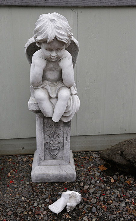 "<div class=""meta ""><span class=""caption-text "">An angel statue lost its feet during the earthquake, at the Napa Valley Mobile Home Park. (AP/Ben Margot)</span></div>"