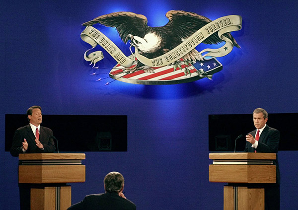 <div class='meta'><div class='origin-logo' data-origin='AP'></div><span class='caption-text' data-credit='Ron Edmonds/AP'>Republican presidential candidate George W. Bush and Democratic presidential candidate Al Gore debate during the first presidential debate Tuesday, Oct. 3, 2000.</span></div>