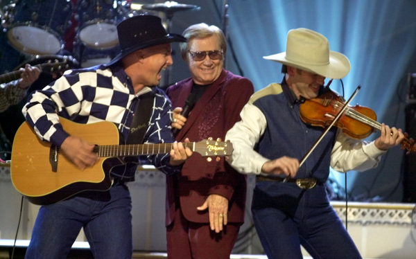 "<div class=""meta image-caption""><div class=""origin-logo origin-image none""><span>none</span></div><span class=""caption-text"">Garth Brooks, left, and George Jones, center, perform their duet ""Beer Run"" at the Country Music Association Awards show in Nashville, Tenn. on Wednesday, Nov. 7, 2001. (M. Spencer Green/AP Photo)</span></div>"