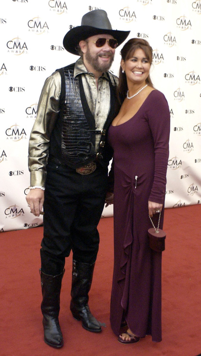 "<div class=""meta image-caption""><div class=""origin-logo origin-image none""><span>none</span></div><span class=""caption-text"">Hank Williams Jr. and his wife, Mary Jane, arrive for the 37th annual Country Music Association Awards show in Nashville, Tenn. in a  Wednesday, Nov. 5, 2003 photo. (M. Spencer Green/AP Photo)</span></div>"