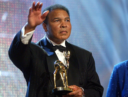 "<div class=""meta image-caption""><div class=""origin-logo origin-image none""><span>none</span></div><span class=""caption-text"">Former heavyweight boxing legend Muhammad Ali waves to the audience after receiving the ""Bambi Trophy"" during the Bambi Media Award in Hamburg, northern Germany. (AP)</span></div>"