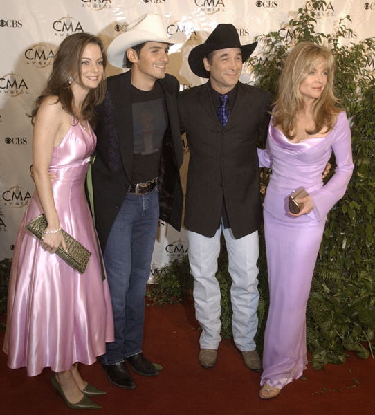 "<div class=""meta image-caption""><div class=""origin-logo origin-image none""><span>none</span></div><span class=""caption-text"">Brad Paisley and Clint Black are joined by their actress wives as they arrive for the Country Music Association Awards show on Nov. 9, 2004 in Nashville, Tenn. (M. Spencer Green/AP Photo)</span></div>"