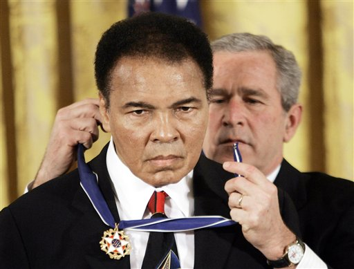 <div class='meta'><div class='origin-logo' data-origin='none'></div><span class='caption-text' data-credit='ASSOCIATED PRESS'>President Bush presents the Presidential Medal of Freedom, Wednesday, Nov. 9, 2005, to boxer Muhammad  Ali in the East Room of the White House.</span></div>