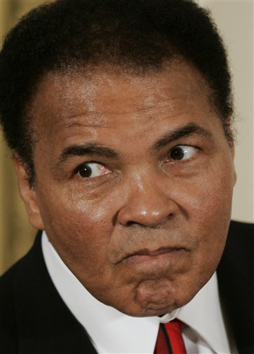 <div class='meta'><div class='origin-logo' data-origin='none'></div><span class='caption-text' data-credit=''>Former boxer Muhammad Ali playfully scowls at photographers before being presented with the Presidential Medal of Freedom in 2005.</span></div>