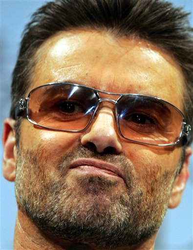 "<div class=""meta image-caption""><div class=""origin-logo origin-image ap""><span>AP</span></div><span class=""caption-text"">British singer George Michael poses for photo session prior to a press conference to promote his documentary film ""George Michael, A differenct story,"" in 2005. (AP Photo/Junji Kurokawa)</span></div>"
