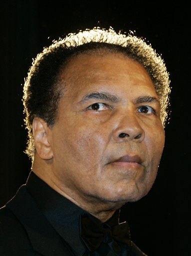 <div class='meta'><div class='origin-logo' data-origin='none'></div><span class='caption-text' data-credit='Franka Bruns/AP Photo'>Boxing legend Muhammad Ali poses for photographers during the award ceremony for the Otto-Hahn-Peace-Medal 2005 of the German Society of the United Nations in Berlin.</span></div>