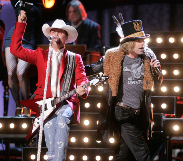 "<div class=""meta image-caption""><div class=""origin-logo origin-image none""><span>none</span></div><span class=""caption-text"">Kenny Alphin and John Rich, of the country music duo Big & Rich, perform during the 41st Annual Country Music Association Awards, Wednesday, Nov. 7, 2007, in Nashville, Tenn. (Mark Humphrey/AP Photo)</span></div>"