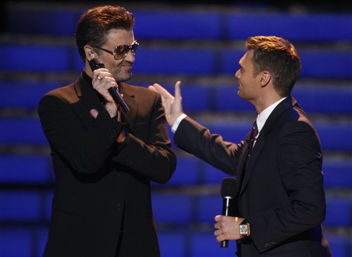 "<div class=""meta image-caption""><div class=""origin-logo origin-image ap""><span>AP</span></div><span class=""caption-text"">George Michael, left, is seen on stage with Ryan Seacrest at the season finale of American Idol on Wednesday May 21, 2008, in Los Angeles. (AP Images for Fox)</span></div>"