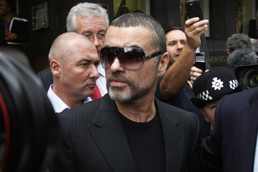"<div class=""meta image-caption""><div class=""origin-logo origin-image ap""><span>AP</span></div><span class=""caption-text"">British singer George Michael leaves Highbury Corner Magistrates Court in north London, Tuesday, Aug. 24, 2010. (ASSOCIATED PRESS)</span></div>"