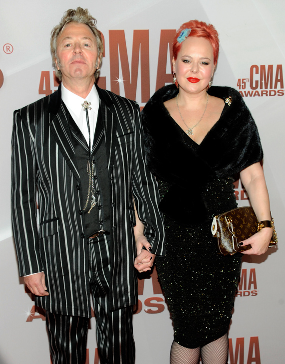 "<div class=""meta image-caption""><div class=""origin-logo origin-image none""><span>none</span></div><span class=""caption-text"">Brian Setzer, left, and guest arrive at the 45th Annual CMA Awards in Nashville, Tenn., on Wednesday, Nov. 9, 2011. (Evan Agostini/AP)</span></div>"