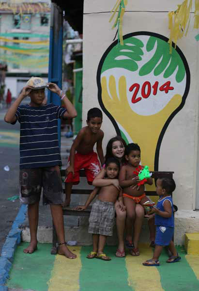Children huddle in front of the 2014 soccer World Cup logo in Fortaleza, Brazil <span class=meta>AP Photo/ Martin Mejia</span>