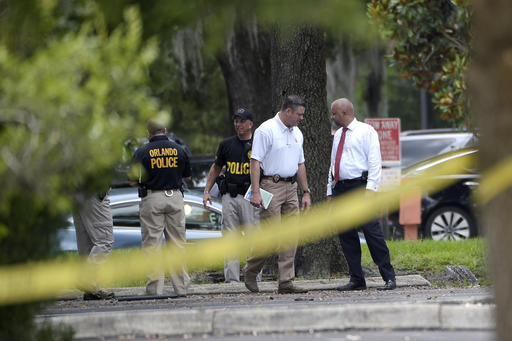 <div class='meta'><div class='origin-logo' data-origin='none'></div><span class='caption-text' data-credit='AP'>Police officials investigate the lot behind the Pulse nightclub.</span></div>
