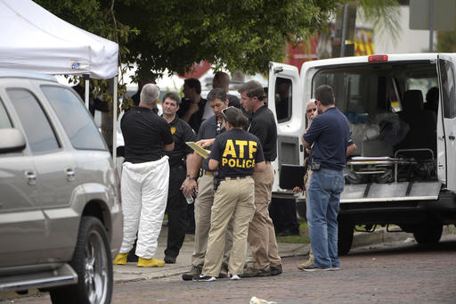 <div class='meta'><div class='origin-logo' data-origin='none'></div><span class='caption-text' data-credit='AP'>Law enforcement officials stand on the street beside the Pulse nightclub</span></div>