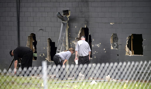 <div class='meta'><div class='origin-logo' data-origin='none'></div><span class='caption-text' data-credit='AP'>Police officials investigate the back of the Pulse nightclub</span></div>