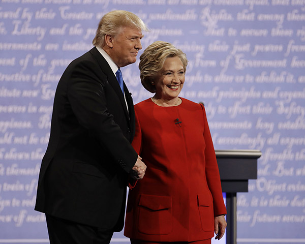 <div class='meta'><div class='origin-logo' data-origin='AP'></div><span class='caption-text' data-credit='Julio Cortez/AP'>Democratic presidential nominee Hillary Clinton shakes hands with Republican presidential nominee Donald Trump during the presidential debate at Hofstra University.</span></div>