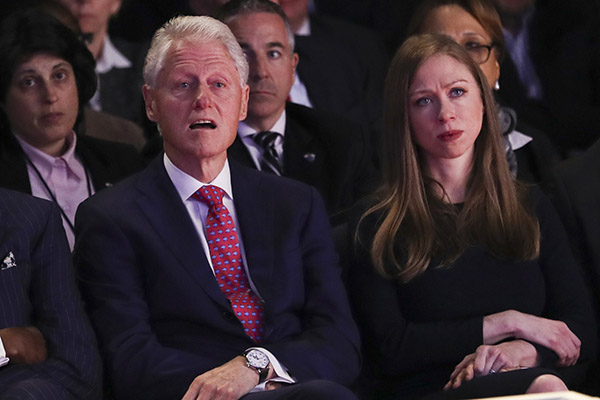<div class='meta'><div class='origin-logo' data-origin='AP'></div><span class='caption-text' data-credit='Joe Raedle/AP'>Former President Bill Clinton and Chelsea Clinton, daughter of Hillary Clinton listen during the presidential debate between Donald Trump and Hillary Clinton at Hofstra University.</span></div>