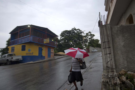 "<div class=""meta image-caption""><div class=""origin-logo origin-image ap""><span>AP</span></div><span class=""caption-text"">A woman walks with an umbrella as protection from a light rain, in Port-au-Prince, Haiti, Monday, Oct. 3, 2016. (Dieu Nalio Chery)</span></div>"